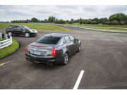 The equipped with V2V technology Cadillac CTS (model 2015) informs the driver before this the oncoming vehicle can see.